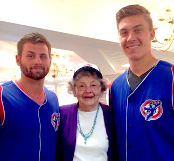 Craig Brooks, left, and Carson Sands of the South Bend Cubs flank a St. Paul's resident.