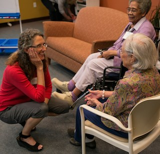 """""""Ultimately, it's an effort to reduce stigma and ease isolation and loneliness,"""" Anne Basting, Ph.D., left, said of her TimeSlips method. (Photo: John D. & Catherine T. MacArthur Foundation.)"""