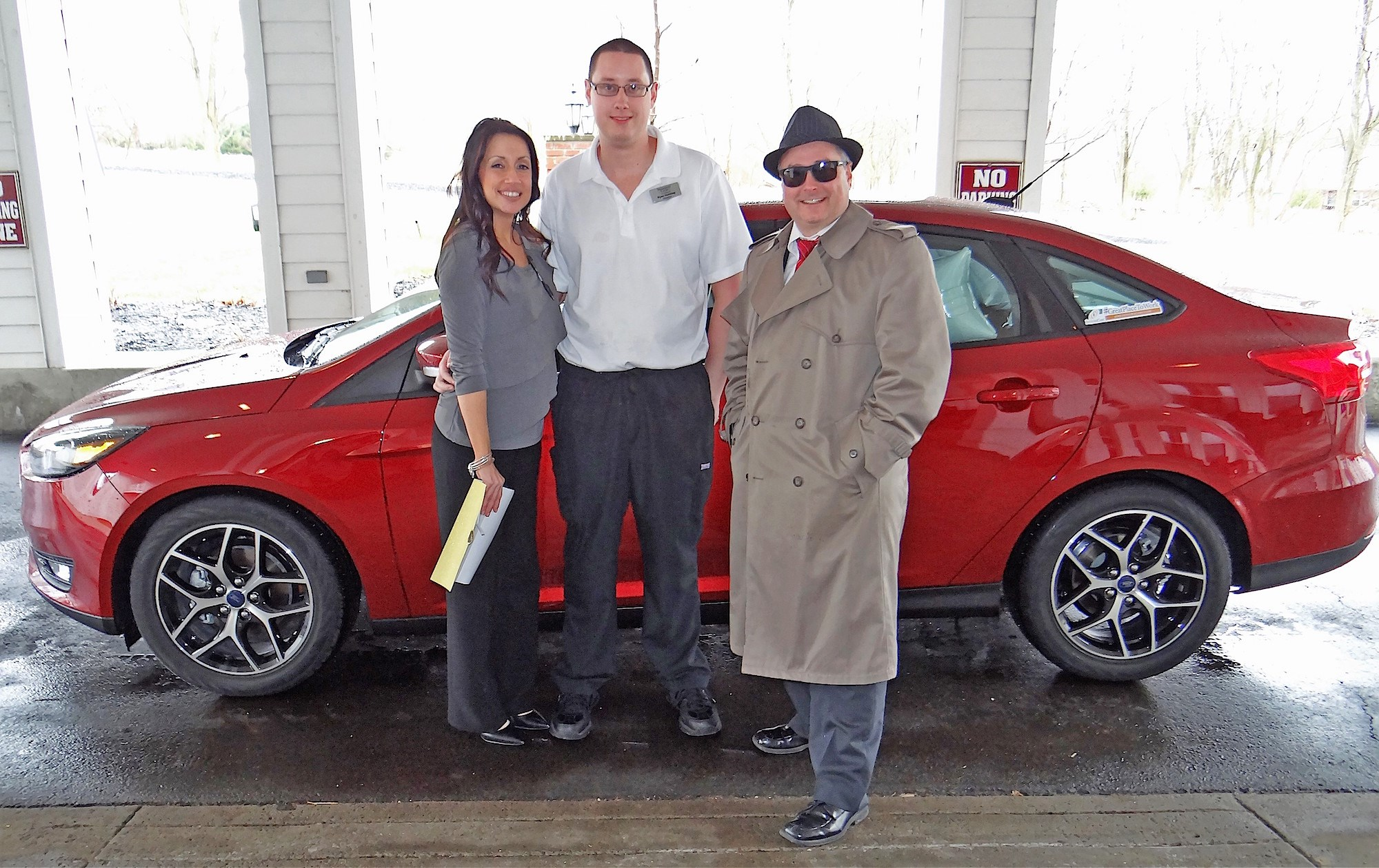 Car winner Ryan Hershey, center, is flanked by Newhaven Court at Lindwood Executive Director Lori Grant and IntegraCare Director of Sales and Marketing Eric Walker.