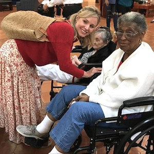 Actress Kristen Bell visits with Atria residents at the Walt Disney Swan and Dolphin Resort. (Photo courtesy of Atria Senior Living)