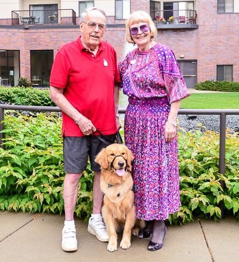 Alta the service dog with Covenant residents Emery and Rubye Erickson.