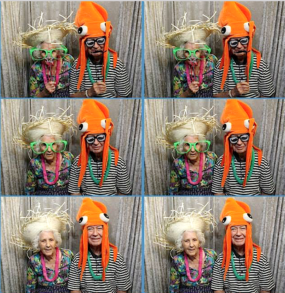 Tallgrass Creek residents enjoy the photo booth at the community's recent luau.