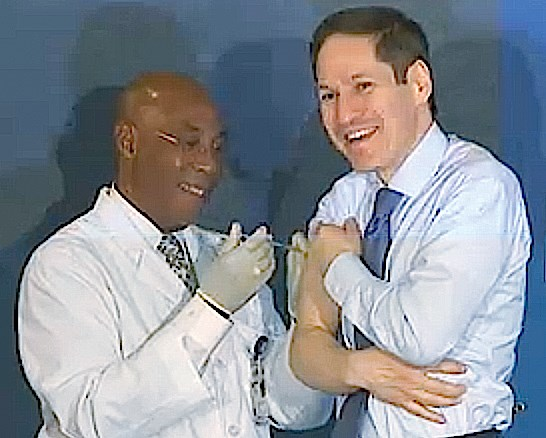 CDC Director Tom Frieden, MD, MPH, gets his flu shot at a press conference.