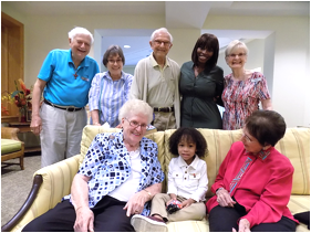 Residents gather around Elijah, 3, and mother Rodlaine Dolcine (back row, second from right).