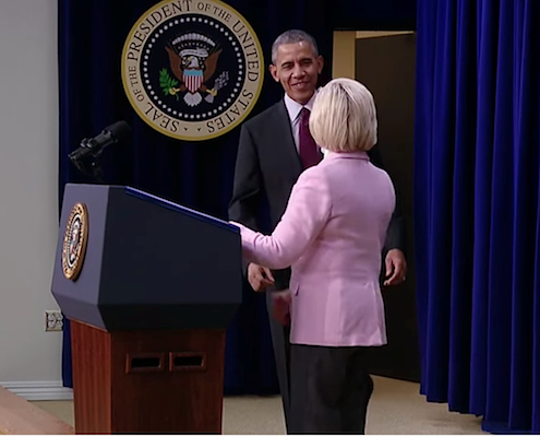 President Barack Obama greets Lilly Ledbetter after she introduces him at a Jan. 29 announcement.