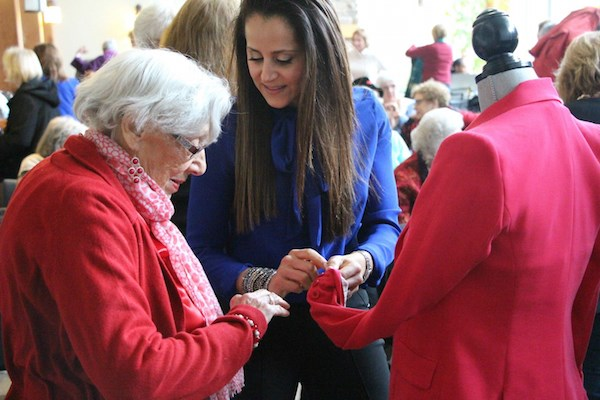 Image consultant Monica Flaum, center, offers personal style tips to a resident.