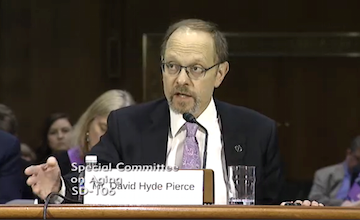 David Hyde Pierce testifies during an April 6 hearing of the Senate Special Committee on Aging.