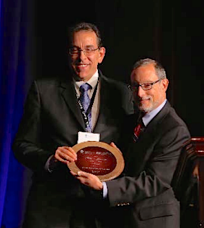 Paul Katz, M.D., C.M.D., right, presents David LeVine, M.D., C.M.D., with his honor.