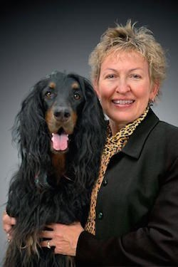 Rebecca Johnson, Ph.D., R.N., F.A.A.N., F.N.A.P., with a canine friend.