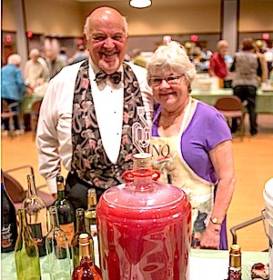 Richard and Donna Brandt show their homemade wine.