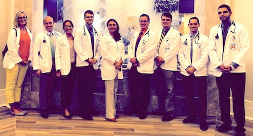 Mariana Dangiolo, M.D., center, poses with UCF medical students at Watercrest of Lake Nona.