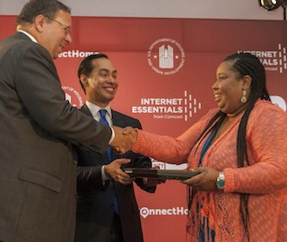 David L. Cohen of Comcast, left, and HUD Sec. Julian Castro are pictured with Karisha Bailey.