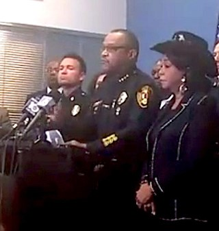 North Miami Police Chief Gary Eugene, center, speaks at a July 21 press conference. U.S. Rep. Frederica Wilson, right, spoke as well. (Still from video on North Miami Police Department Facebook page)