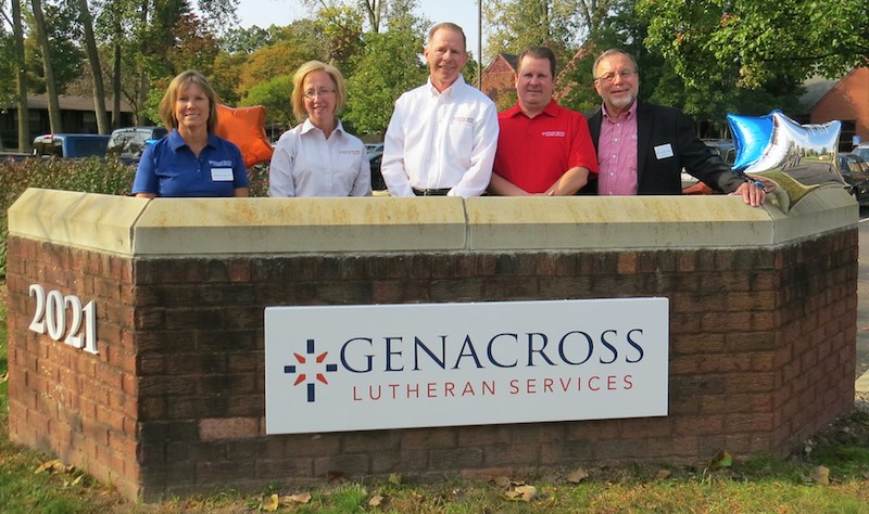 Genacross' leaders unveil a new sign Tuesday in front of the nonprofit organization's main office in Toledo, OH. (See below for names.)