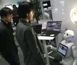 A prototype IBM Multi-Purpose Eldercare Robot Assistant, right (full IDs below).