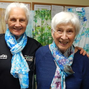 Residence at Otter Creek residents model the silk scarves they made.