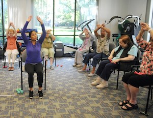 Residents exercise at Hebrew SeniorLife's Simon C. Fireman Community.