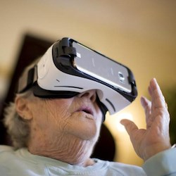 An assisted living resident tries the virtual reality system. (Photo: MIT)