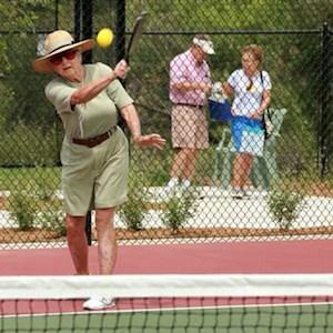 Dee Grace demonstrates her paddle technique on Morningside's new pickleball court.