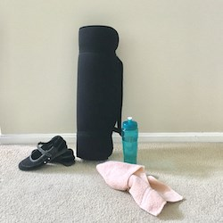 A mat, shoes, towel and water bottle are some of the items used when practicing yoga.