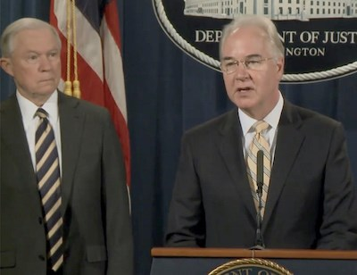 Attorney General Jeff Sessions, left, looks on as HHS Secretary Tom Price, M.D., speaks about the healthcare fraud takedown.