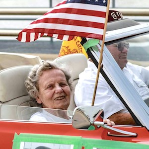 Dorothy Nimmer enjoys her time as grand marshal of the Winneconne Sovereign State Days parade. (Photo by Doug Sasse courtesy of Gabriel's Landing / Miravida Living)