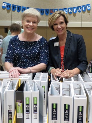 Vi at Bentley Village resident Louise Owens, left, and Executive Director Penny Smith were among those helping fill backpacks with school supplies for area kids at a recent Operation Backpack event.