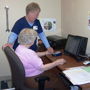 A resident served by Lutheran Senior Services uses a telehealth kiosk. (Photo courtesy of LSS)