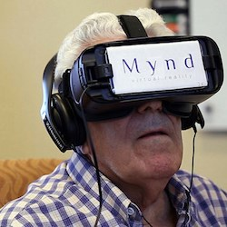 A senior living resident watches virtual reality content.