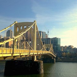 "One of Pittsburgh's nicknames is ""The City of Bridges."" Several yellow ones cross rivers in the downtown area. (Photo by Lois Bowers)"
