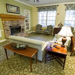The community living room at Brookdale Pensacola. The installation of sensors that turn off lights in unoccupied common areas has helped Brookdale communities earn Energy Star certification.