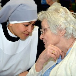 A Little Sister of the Poor speaks with a resident in her care. (Photo: The Becket Fund for Religious Liberty)