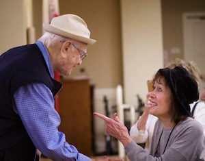 University Village resident Sondra Krakower, right, enjoys a little one-on-one time with Norman Lear. (Photo: Michael Adams)