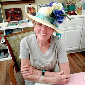 Jeanne Bishop said she wanted her hat to look like a colorful spring meadow.
