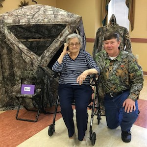 Resident Ruth Urbain and her son Frank enjoy the outdoor show at Garvey Manor and Our Lady of the Alleghenies Residence.