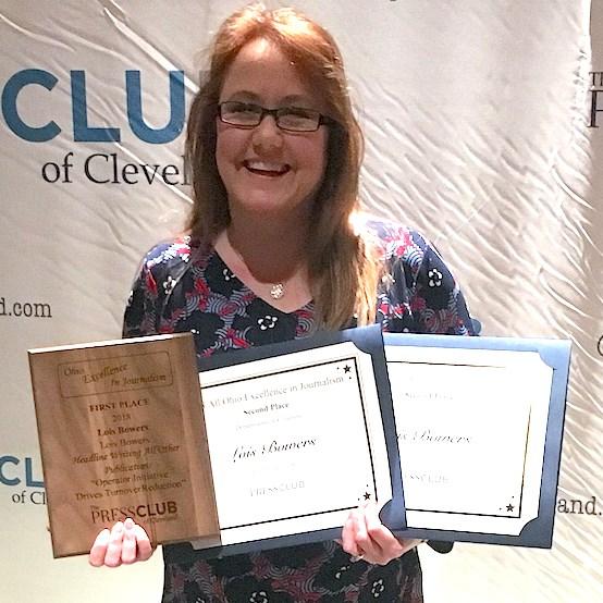 McKnight's Senior Living Senior Editor Lois A. Bowers strikes a pose with her three awards.