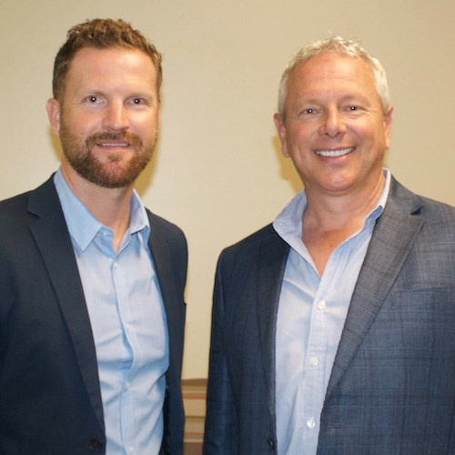 Solinity President and CEO Joshua Crisp, left, will lead the management team for Sierra Cove Group of Companies CEO Terry Scott's newly acquired CaraVita Village community in Montgomery, AL.